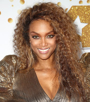 Tyra Banks rocked teased curls at the 'America's Got Talent' season 13 live show.
