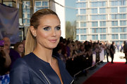To counter-balance a bold eye look, Heidi Klum chose a light pink lipstick.