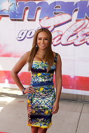 Mel B showed off her curves with this super feminie patterned dress, which she wore to he 'America's Got Talent' event in Illinois.