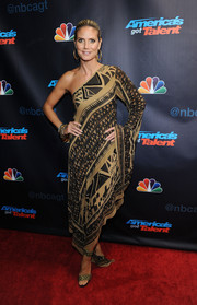 Heidi Klum stepped out on the 'America's Got Talent' red carpet wearing gold ankle-wrap sandals that matched the style of her dress.