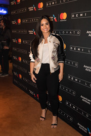 Demi Lovato stayed on trend in an embroidered bomber jacket by Stella McCartney for a performance at House of Blues Dallas.