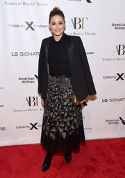 Olivia Palermo topped off her outfit with a black tux jacket.