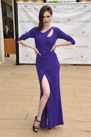 Coco Rocha paired her gown with chic black strappy sandals.