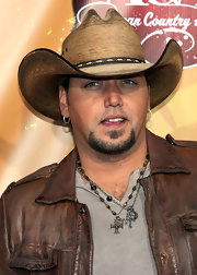 Jason added a nice touch to his distressed leather jacket with a straw cowboy hat.