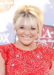 Lauren Alaina attended the American Country Awards wearing a puffy bun with wispy bangs.