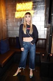 Suki Waterhouse dressed up her edgy outfit with a pair of printed slingback pumps.