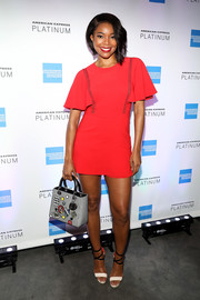 Gabrielle Union styled her frock with a patched purse by Dior.