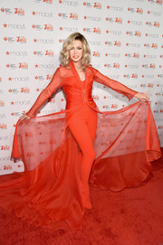 Donna Mills struck a pose in a Mark Zunino Couture chiffon robe and catsuit combo during the American Heart Association Go Red for Women event.