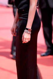 Kristen Stewart paired her bracelet with an equally elegant Chanel watch.
