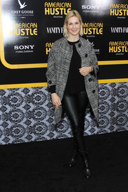 Kelly Rutherford completed her casual-edgy ensemble with a pair of black mid-calf boots.