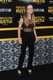 Emily Meade flashed some bra in a tight-fitting, sheer black top at the 'American Hustle' premiere in NYC.