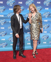 Nicole Kidman walked on the wild side in a belted leopard-print dress during the 'American Idol' XIV grand finale.