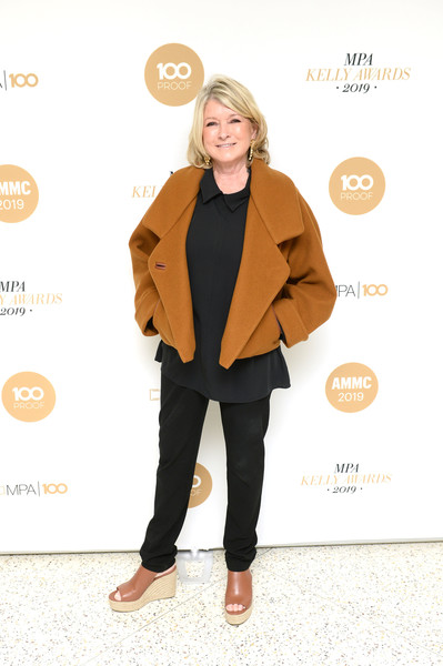 Martha Stewart teamed black slacks with a matching top and an ochre jacket for the American Magazine Media Conference 2019.