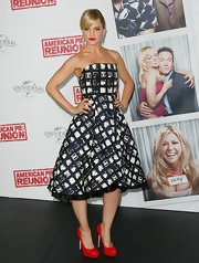 Mena Suvari added a pop of color with red patent leather platform pumps.