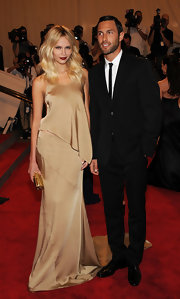 Natasha Poly sported this satin gold mermaid gown for a luxurious and glamorous red carpet look.