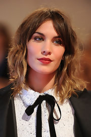Alexa Chung amped up her natural look with deep red lips.