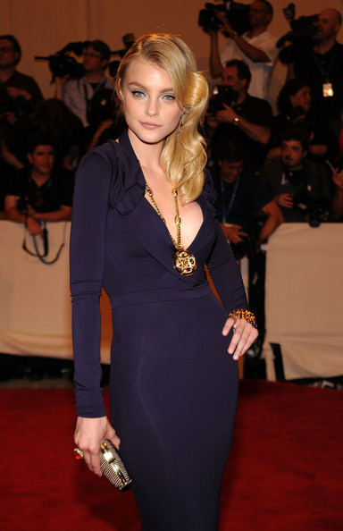 A yellow sapphire, citrine, and diamond pendant necklace by Bulgari stood out against Jessica Stam's sexy purple gown.