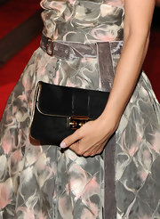 Rachel Bilson showed off her breathtaking Louis Vuitton dress which came straight off the Spring 2010 runway. She paired it with an equally gorgeous envelope clutch.