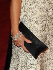 TV correspondent Katie Couric kept her clutch simple while hitting the MET Gala red carpet. It was a great choice, which allowed her dress to take center stage.