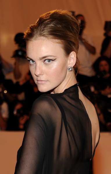 Caroline Trentini swept her hair up in a twisted bun to allow her sheer dress to shine on the red carpet.