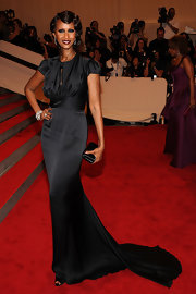 Iman was picture perfect at the Met Gala in NYC in a sweeping black gown. Her simple black satin box clutch perfectly complemented the glamorous look.