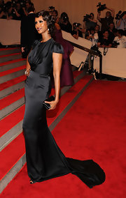 Iman was the epitome of elegance at the 2010 Met Gala in a black satin gown and retro finger waves.