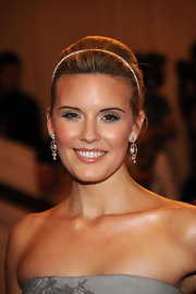 Actress Maggie Grace showed off her glamorous side while attending the MET Gala. She donned a classic bun and topped it off with a diamond headband.