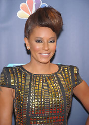Mel B traded in her signature voluminous curls for another daring look — the retro pompadour.