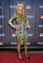 Heidi got graphic with this yellow, white, and black leopard-print body con dress.