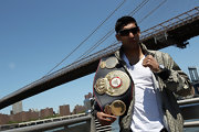 Amir Khan was sporting a hip pair of designer shield shades as he posed with his boxing world championship belt in 2010.