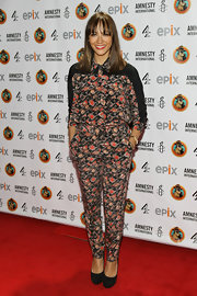 Rashida Jones embraced a full dose of florals in busy high-waist slacks and a matching blouse.