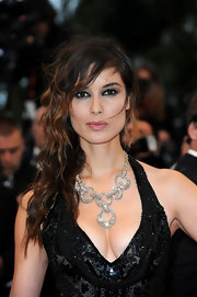 Berenice Marlohe arrived at the 'Amour' premiere wearing a silver crystal 'Rarely' necklace.