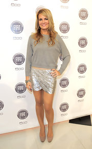 Courtney put together a unique ensemble with this gray crewneck sweater and sequined mini.