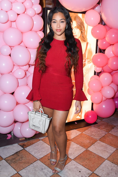 Jordyn Woods styled her frock with strappy silver heels.
