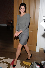 Gemma completed her sophisticated ensemble with patent Pigalle stilettos.