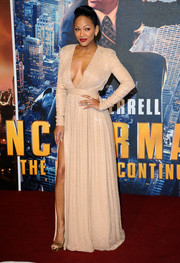 Meagan Good sizzled on the red carpet in a nude Ralph & Russo evening dress with a revealing neckline and a thigh-high slit during the premiere of 'Anchorman 2.'