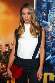 A chic red leather clutch injected some color into Lauren Pope's neutral outfit at the 'Anchorman 2' premiere.