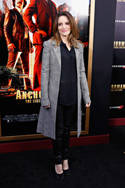 Tina Fey looked flawlessly stylish in a gray coat, a sheer button-down, and leather skinnies at the 'Anchorman 2' NYC premiere.