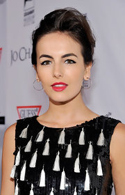 Camilla Belle wore her hair in a casual bobby-pinned updo at the Andrea Bocelli Foundation launch.