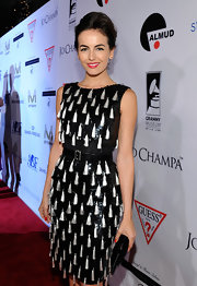 Camilla Belle let her tasseled Oscar de la Renta shine by pairing it with a classic black clutch.
