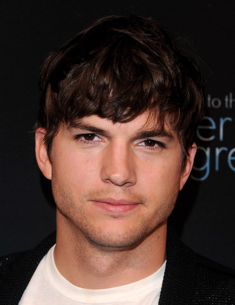 Ashton Kutcher showed off his signature messy haircut while hitting the Andy Samberg party.