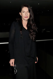 Marina Abramovic exuded a goth vibe in her loose black blouse and skirt.