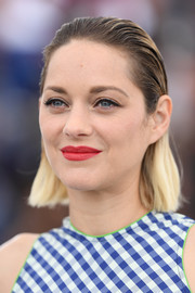 Marion Cotillard lit up her face with a swipe of red lipstick.