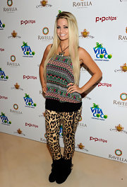 Angel wears bold leopard print leggings with her bohemian top while at Las Vegas for Memorial Weekend.