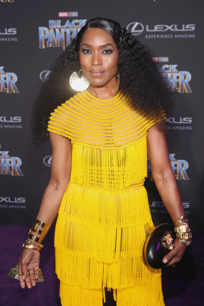 Angela Bassett Gold Bracelet [black panther,yellow,hairstyle,premiere,shoulder,fashion,award,dress,carpet,black hair,event,angela bassett,california,hollywood,dolby theatre,marvel studios,los angeles world premiere]