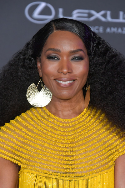 Angela Bassett Gold Dangle Earrings [black panther,hair,hairstyle,eyebrow,yellow,beauty,lip,fashion,black hair,long hair,smile,angela bassett,arrivals,california,hollywood,dolby theatre,disney,marvel,premiere,premiere]