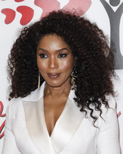 Angela Bassett rocked her signature voluminous curls at the Hearts for Hope Gala.