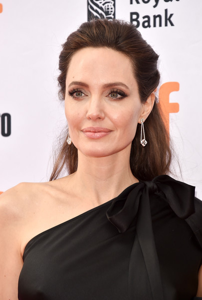 Angelina Jolie Dangling Diamond Earrings [first they killed my father,hair,face,hairstyle,eyebrow,shoulder,skin,beauty,lip,chin,dress,angelina jolie,toronto,canada,princess of wales theatre,toronto international film festival]