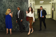 Angelina Jolie kept it business-like in a white button-down while visiting the United Nations.