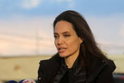 Angelina Jolie visited the Zaatari refugee camp in Jordan wearing a casual straight hairstyle.